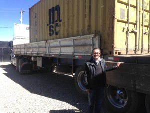 Juan Pablo stands besides a container of orgnaic quinoa ready for export to the US through Arica, Chile.